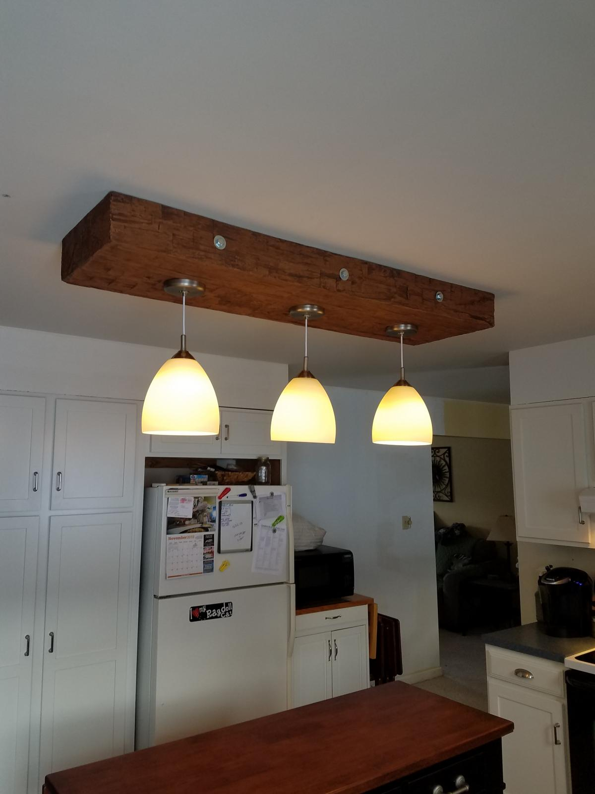 faux beams make beautiful accents for lighting